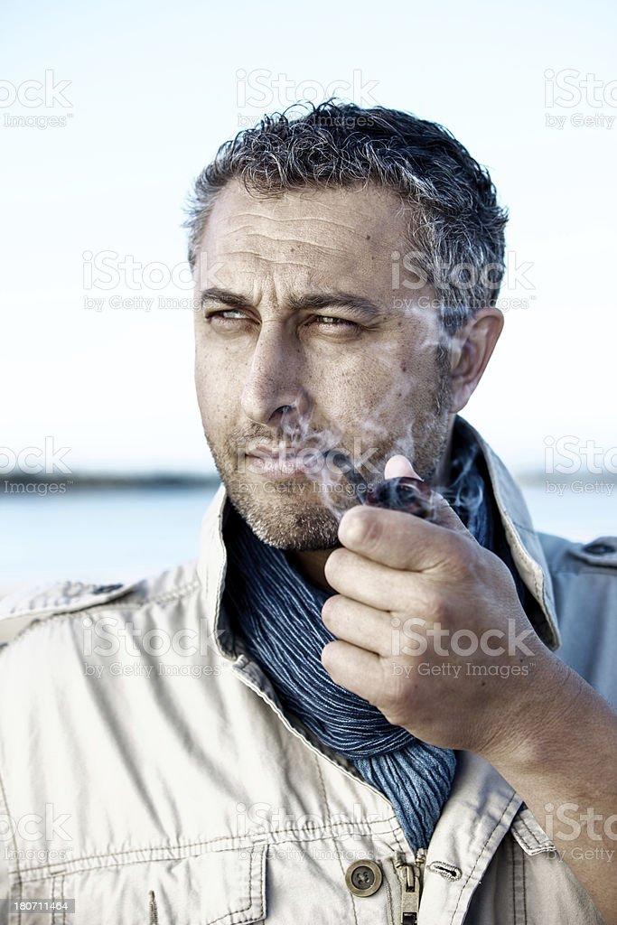 Man smoking a pipe royalty-free stock photo