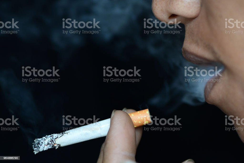 man smoking a sigarette royalty-free stock photo
