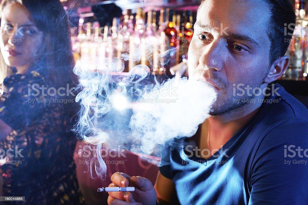Man smoking and exhaling plume of smoke royalty-free stock photo