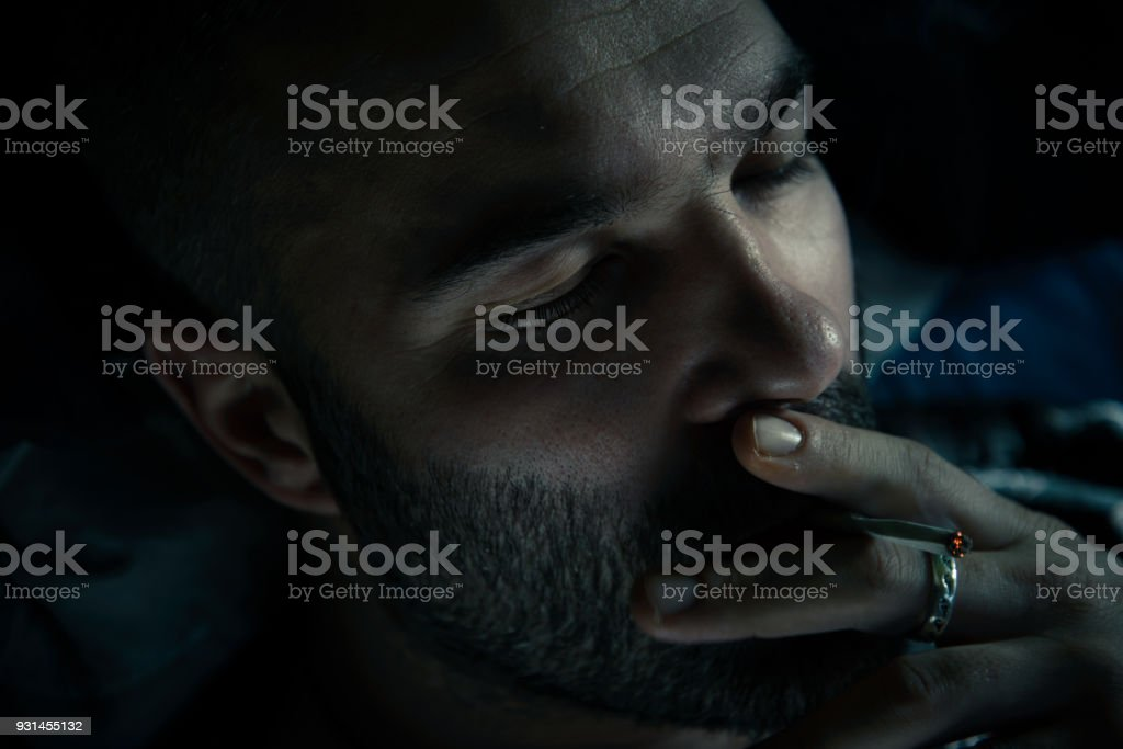 Man smoking cigarette stock photo
