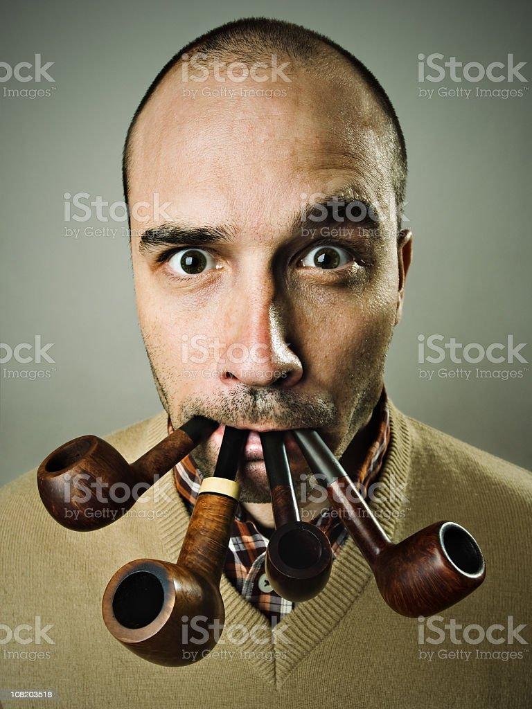 Man Smoking Four Pipes royalty-free stock photo