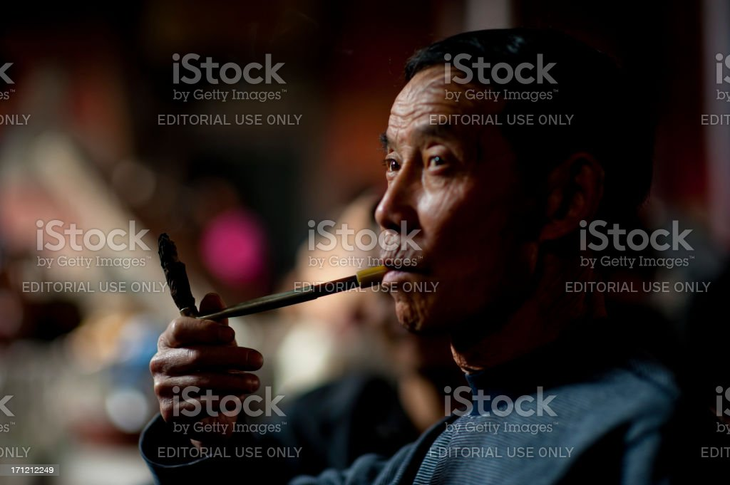 9de88fdf4 Man smoking in old tea house, Chengdu, China royalty-free stock photo