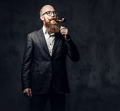 istock A man smoking tradition pipe. 1074571400