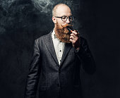 istock A man smoking tradition pipe. 1074586394