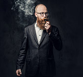 istock A man smoking tradition pipe. 1074591768