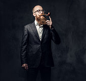 istock A man smoking tradition pipe. 1074593994