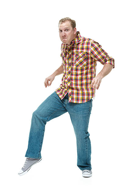 Man sneaking around and tip toeing stock photo