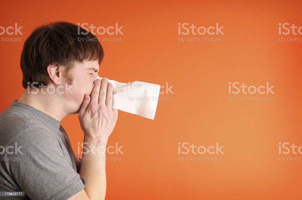 Man Sneezing stock photo