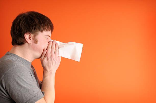 Man Sneezing stock photo