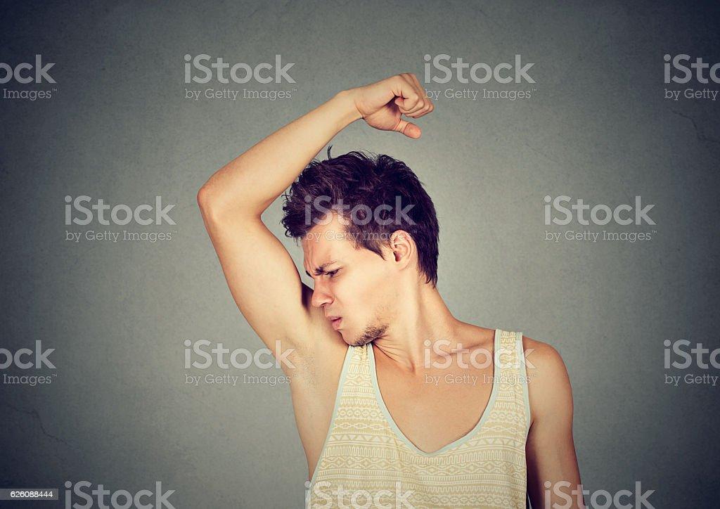 man sniffing his armpit something stinks bad odor stock photo