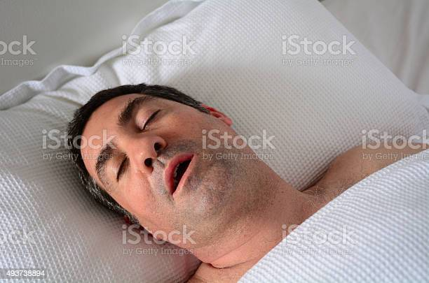Man Snoring In Bed Stock Photo - Download Image Now