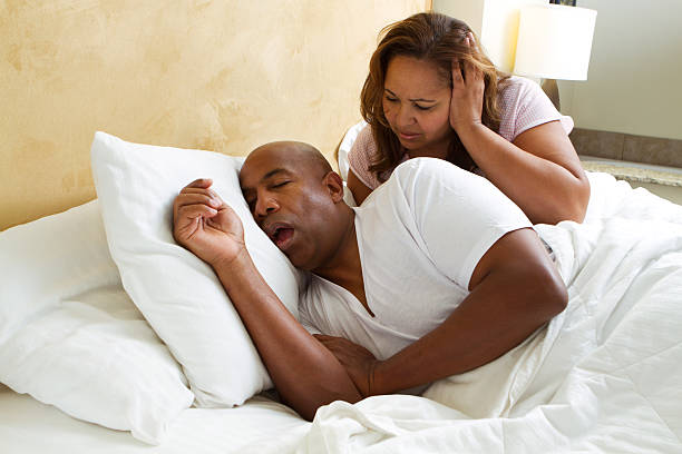 Man Snoring With His Mouth Open stock photo