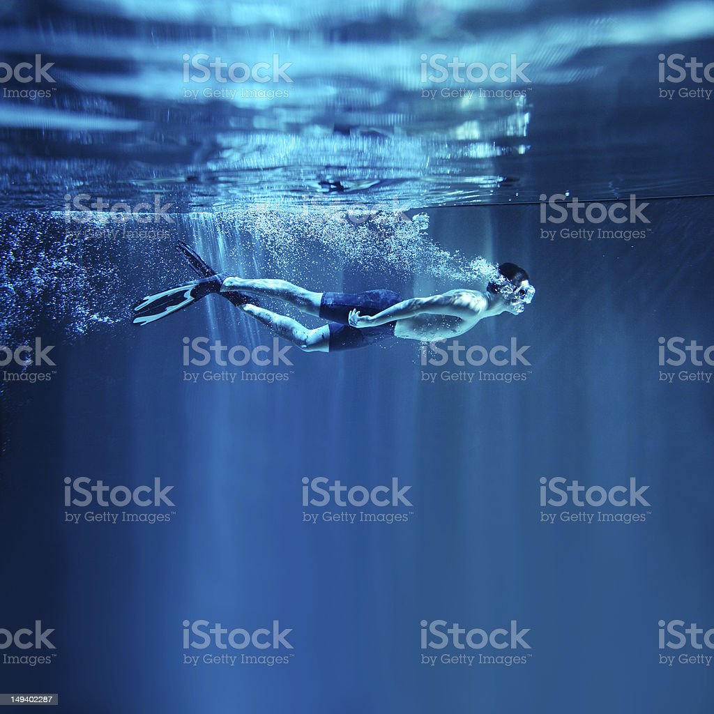 Man snorkeling on blue background, underwater view stock photo