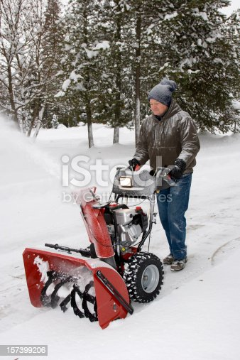 A man with his Snow Blower.
