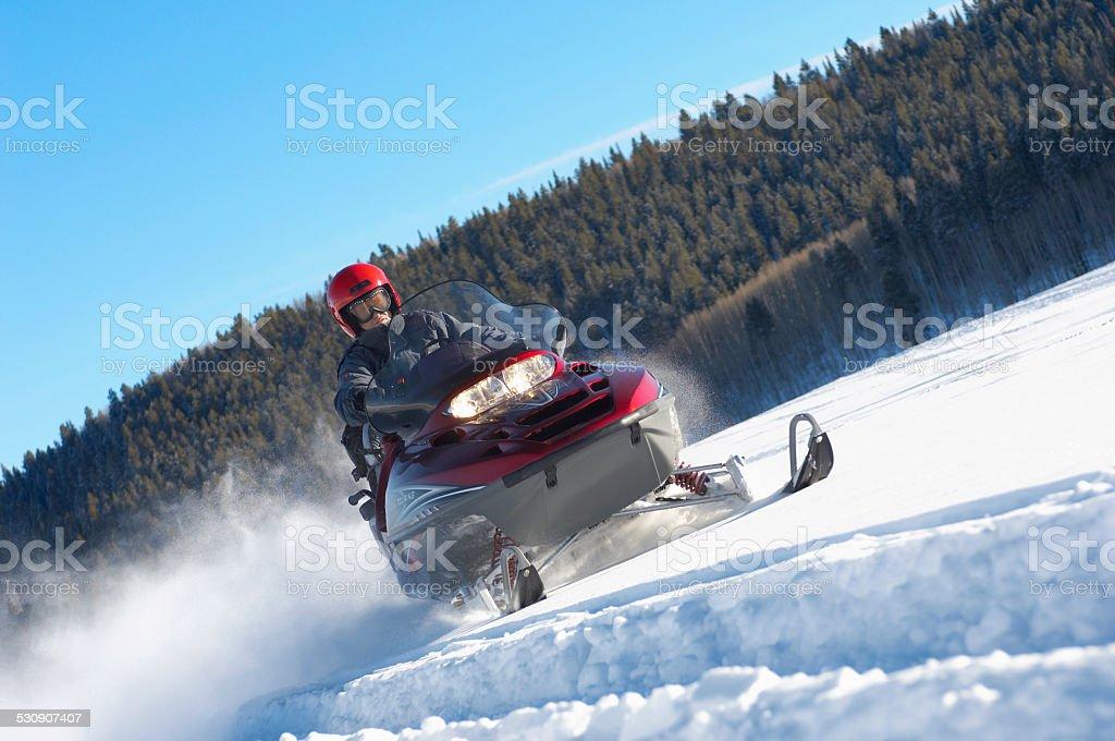 Man Snowmobiling stock photo