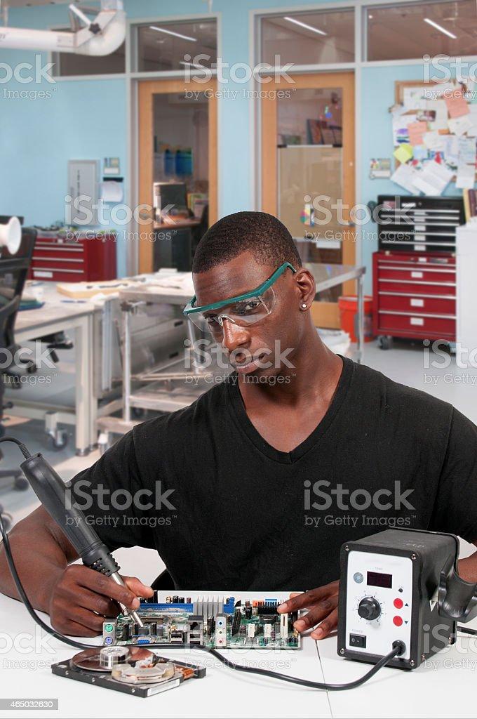 Man soldering stock photo