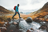 istock Man solo traveling backpacker hiking in scandinavian mountains active healthy lifestyle adventure journey vacations 1263344362