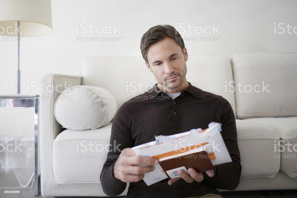 Man sorting bills at home royalty-free stock photo
