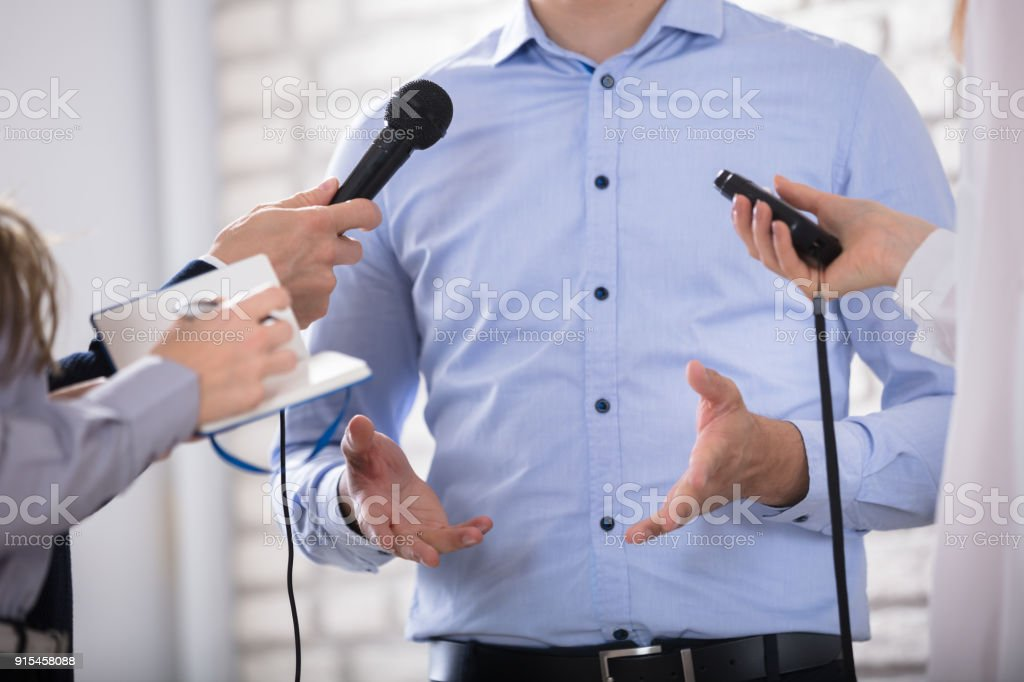 A Businessman Answering Questions During The Press Conference