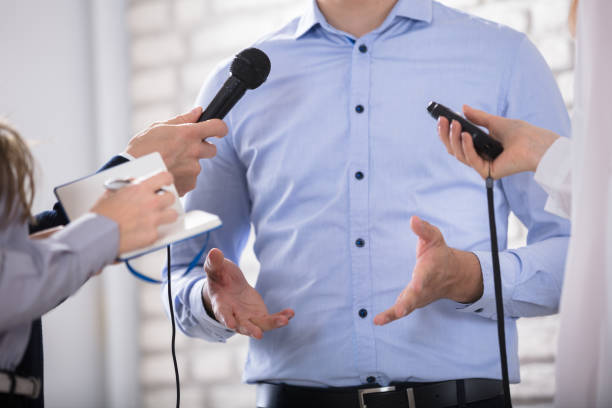 Man Speak Into The Mike In The Media stock photo