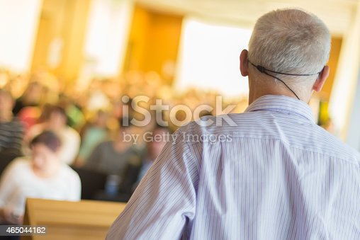 595328682 istock photo A man speaking in front of a group of people 465044162