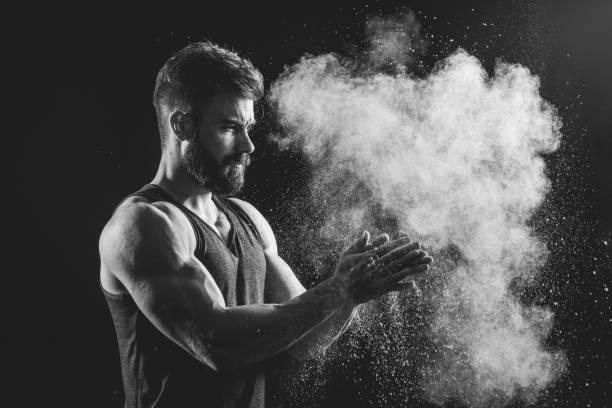 Man splashing colorful powder stock photo