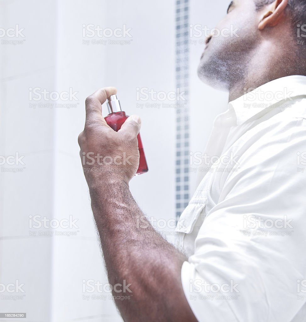 Man spraying aftershave stock photo