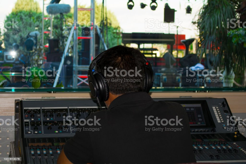 man stage sound mixer at sound engineer hand using audio mix .Voice control and live broadcast concerts concept.