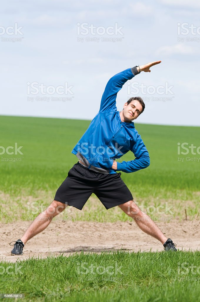 man stand and strech the side stock photo
