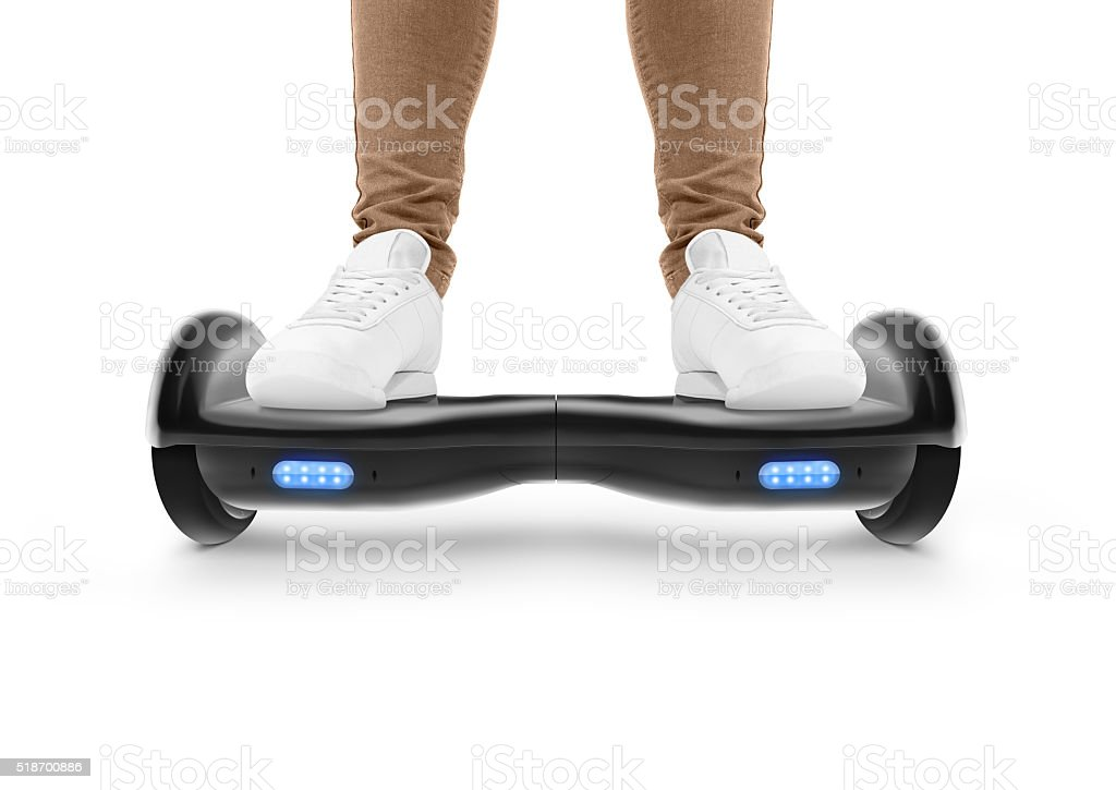 Man stand on black hover board isolated stock photo