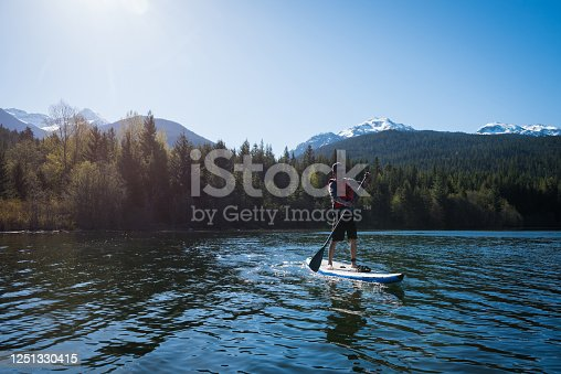 Paddleboarding in Whistler, Canada. Canada's top tourist destiantions. Green Lake in Whistler, BC, Canada.