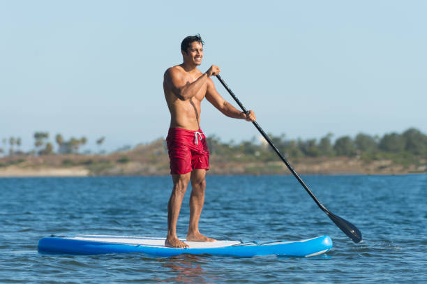 Man Stand Up Paddle Boarding stock photo
