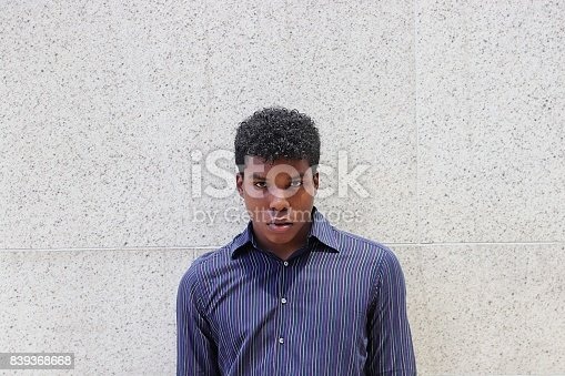 istock man standing against gray textured wall 839368668