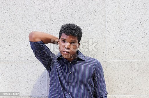 istock man standing against gray textured wall 839369092