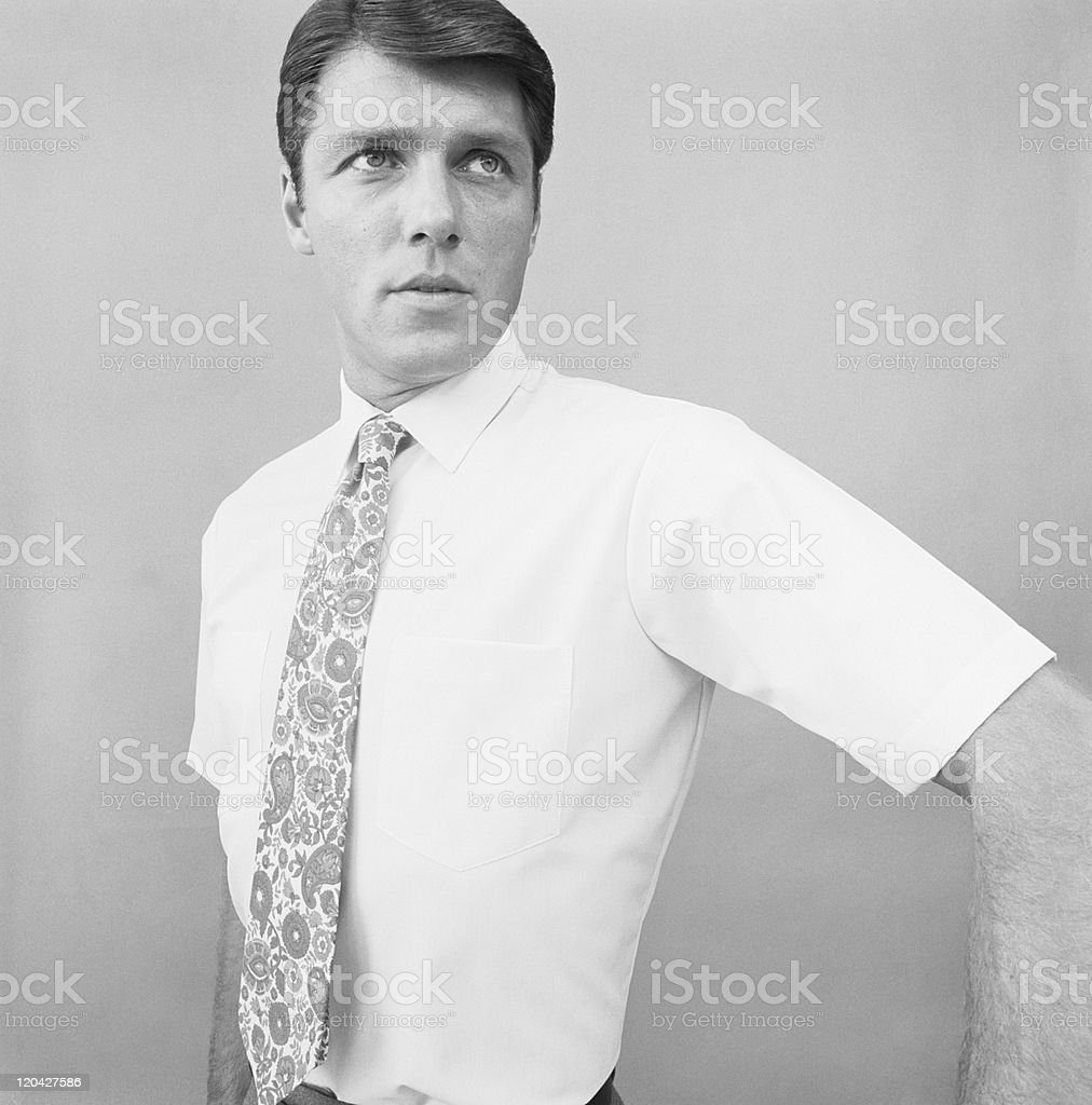 Man standing against grey background, close-up royalty-free stock photo