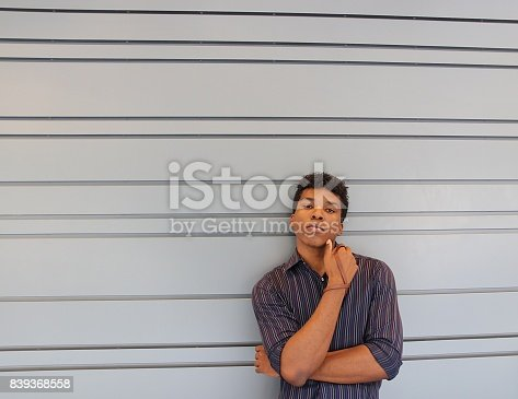 istock man standing against lined wall 839368558