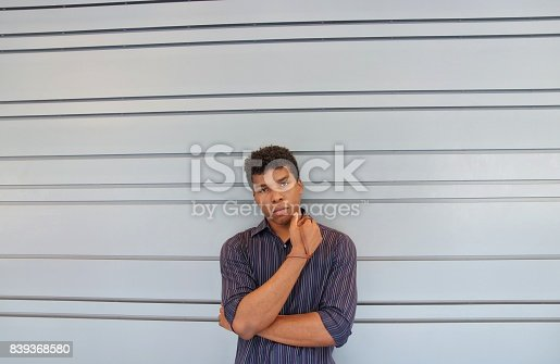 istock man standing against lined wall 839368580