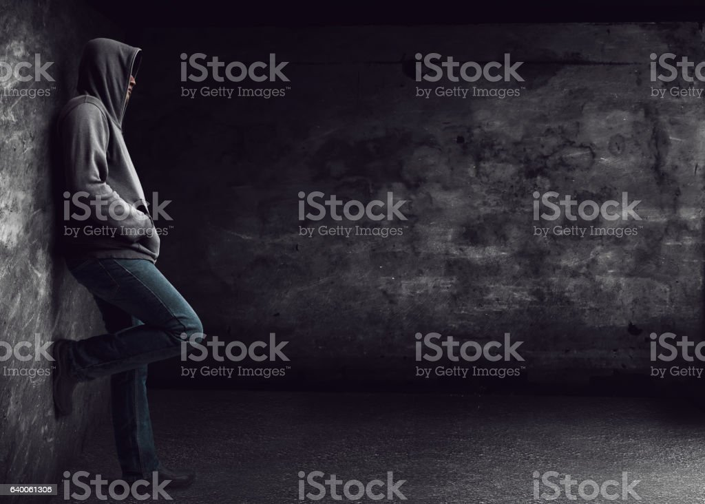 Man standing alone at night stock photo