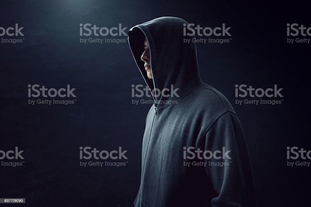 Man standing alone in dark room stock photo