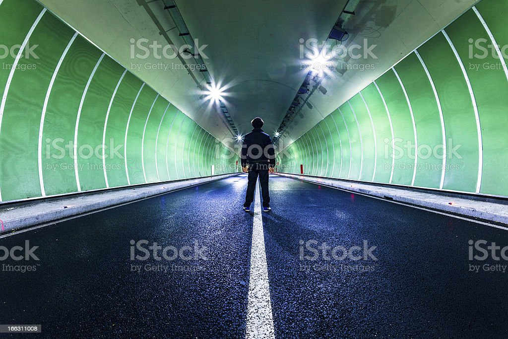 Man Standing Alone in Middle of the Road stock photo