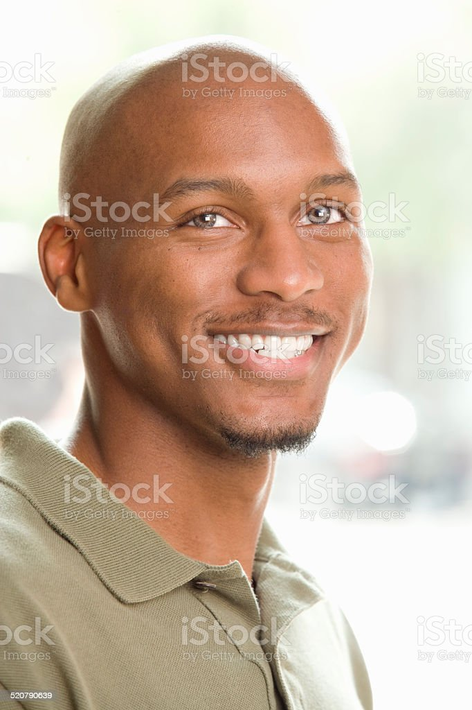 Man Standing and Smiling Looking Up stock photo