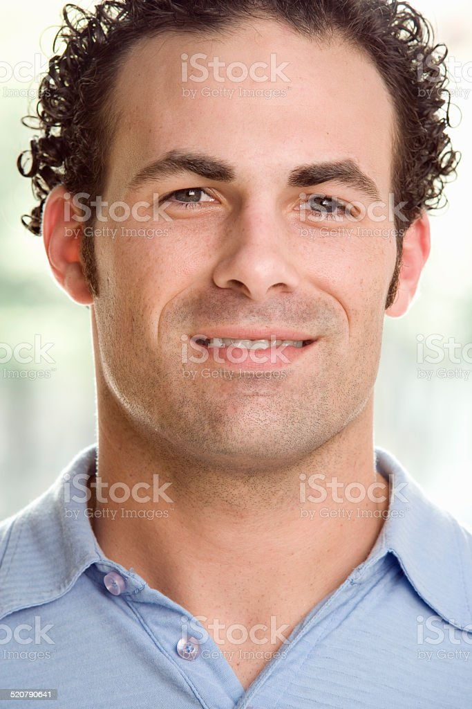 Man Standing and Smiling stock photo