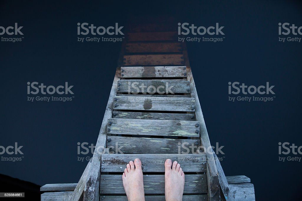 Man standing and thinking on a pier stock photo