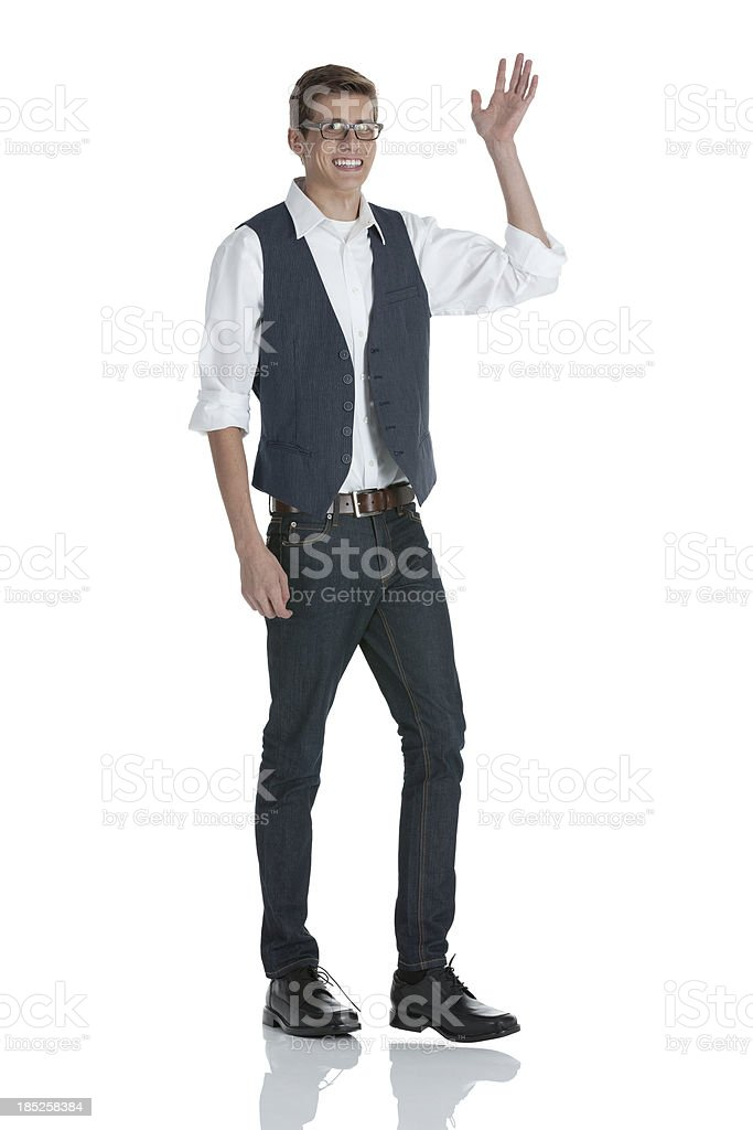 Man standing and waving hand stock photo
