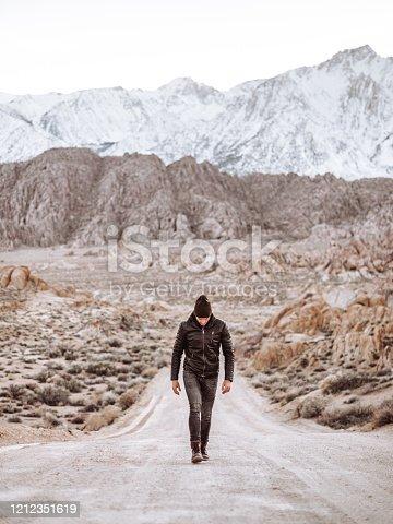 man standing at Alabama Hills