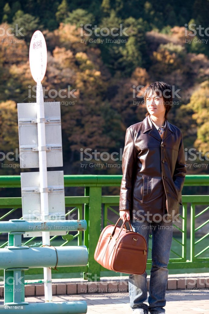 Man standing at the bus stop royalty-free stock photo