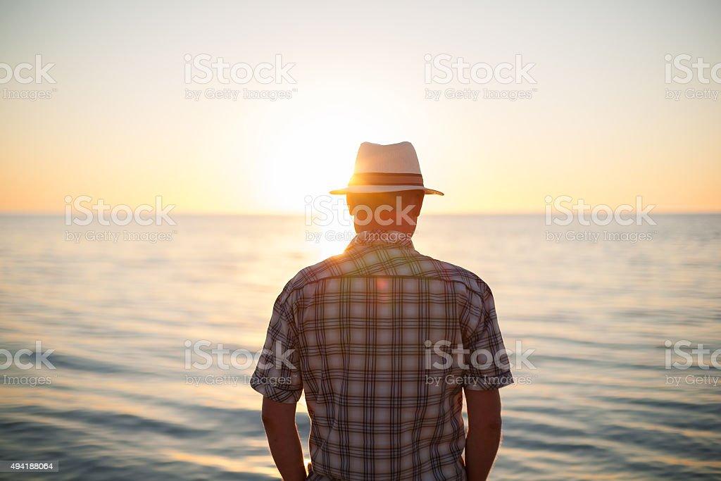 man standing backlight sunset lighting back view stock photo