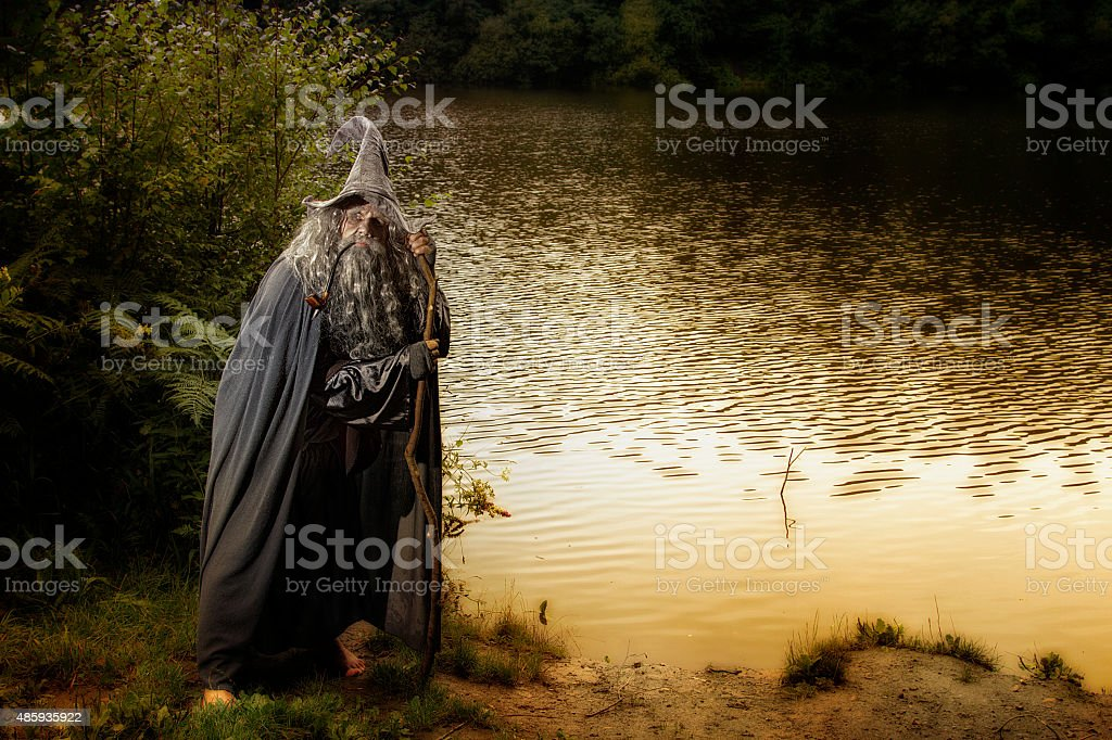 Man standing by a lake outdoors in costume stock photo