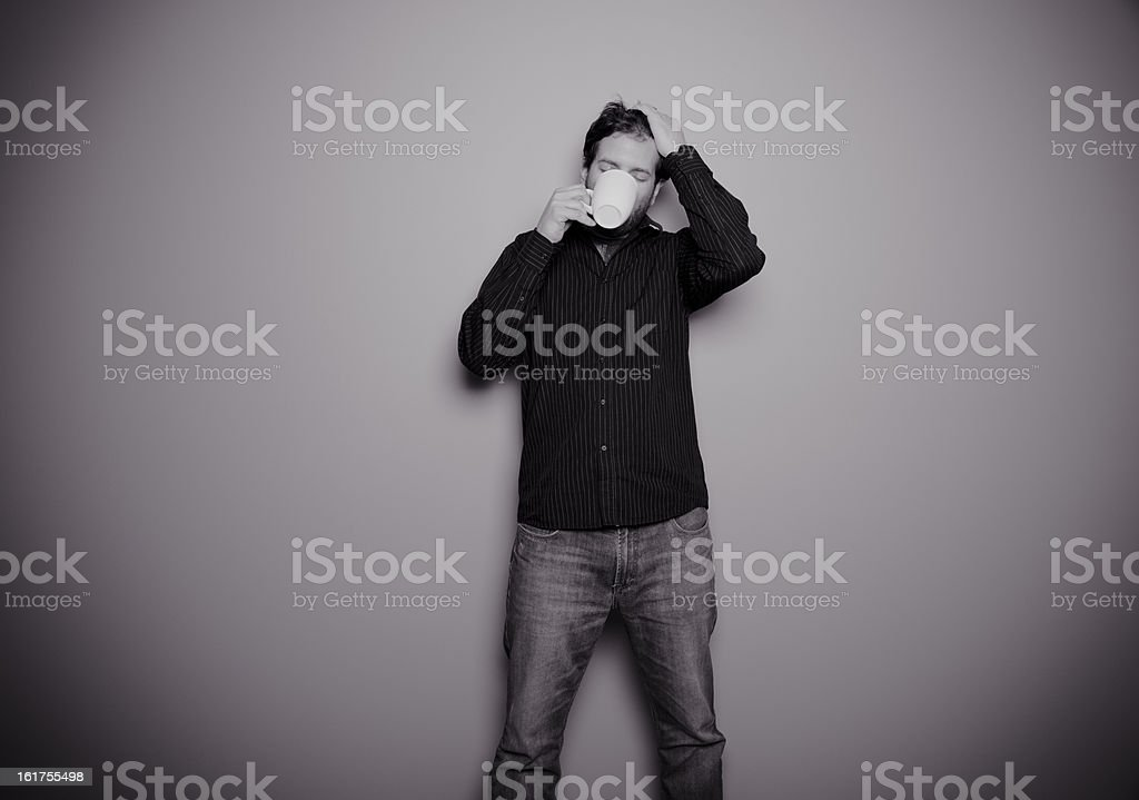Man Standing Drinking from a Mug royalty-free stock photo