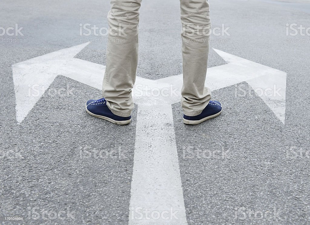 Man standing hesitating to make decision stock photo